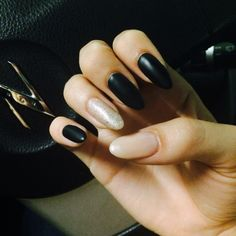 Matte black and nude almond nails