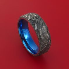 Damascus Steel Ring with Rock Hammer Finish and Anodized Titanium Sleeve Custom Made Damascus Ring, Damascus Steel, Custom Wedding Rings, Wedding Ring Bands, Rings For Men, Rock, Sleeve, Wedding Stuff, Dream Wedding