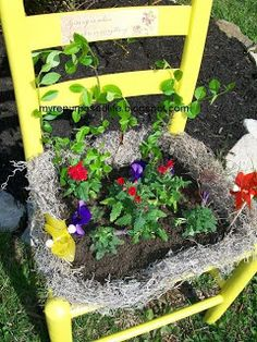 repurposed chair for the garden~staple screening to old chair (without seat), then staple black planting material~ add soil & moss and you are ready to plant