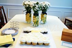 Some table decorations for a southern bridal shower--mason jar centerpieces with daisy and lemon accents