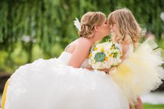 Photo Credit: Julie Nicole Photography Why We Love It We love this sweet photo of the bride with her flower girl!