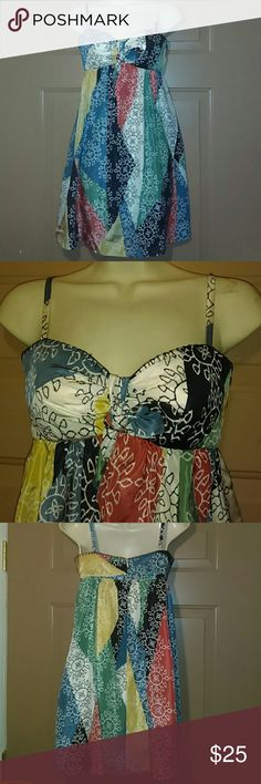 """NWOT BCBGMAXAZRIA SILK DRESS-SIZE 4-ADORABLE!!! -BCBGMAXAZRIA Silk Dress, Or can be worn as a long top -Size 4 -Extremely Adorable -New, Has never been worn -Armpit to armpit measures 17"""" , straight across -Adjustable straps -From the top of the body of the dress, to the bottom hem measures 27"""" -12"""" zipper goes down middle of back -Fully lined -100% Silk -Lining: 100% Polyester BCBGMAXAZRIA Dresses"""