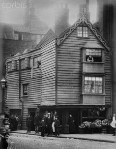 BARTHOLOMEW CLOSE, City of London. General view of an old timber boarded house, latterly a shop, possibly medieval.