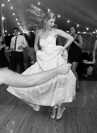 Bride Sandy dancing in her custom Milk and Honey wedding shoes