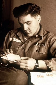 Elvis reading fan mail whilst in the Army...