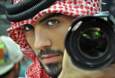 Omar Borkan Al Gala. He is a Fashion photographer, actor and poet from Dubai.