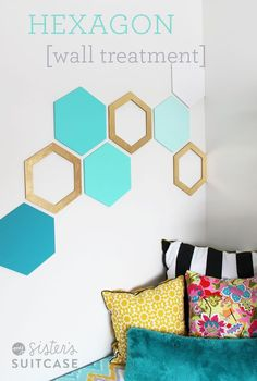 Geometric hexagon art to decorate a plain wall. Buy the shapes or make your own out of plywood or cardboard.