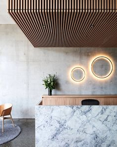 Wouldn't mind working a Saturday shift here. Great L lobby and reception design. Love the material combination of concrete, marble, and wood.