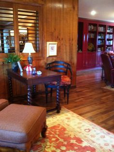 We saved the wood paneling and added hickory floors.