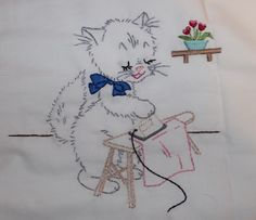 Hand embroidered kitten.