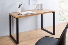 A simple office desk with table top in dark colour and steel legs, powder painted in black. Office Furniture, Office Desk, Home Furniture, Furniture Design, Black Desk, Bureau Design, Chair Upholstery, Upholstered Furniture, Adjustable Height Desk