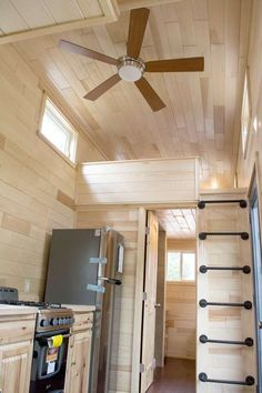 Natural wood finishes give the house a cozy cabin feel. Hand scraped hardwood flooring was used throughout the main floor, and a ceiling fan and two wall heaters keep the home comfortable.