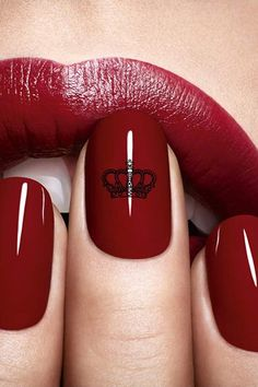 Regal crown print on a Dior Vernis Red Royalty manicure