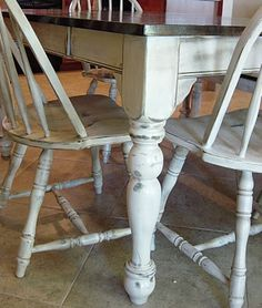 decided to change the whole appearance of the table by painting the legs a lovely shade of Heirloom White from Home Depot (my favorite), staining the top a rich Jacobean by Miniwax (also found at Home Depot), distressing the whole thing, glazing it, and then polyurethaning the heck out of it (nine coats, to be exact).