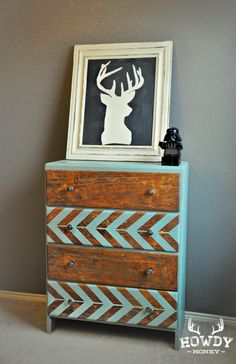 Deer painting & rustic dresser with two tone herringbone and wood.
