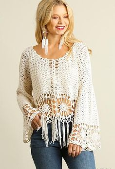 No other tops can hold a candle to the Knit Crochet Top with Fringe hemline. This sweater has a round neckline and long flowy bell sleeves topping its roomy bod