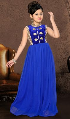 Blue shade net gown flaunts floral jacquard patterned and paisley designed appliques decked to the upper torso heightens the attire charm. #CharmingLookFloorLengthGirlGown