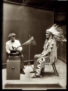 1916    Frances Densmore recording Blackfoot chief Mountain Chief on a cylinder phonograph for the Bureau of American Ethnology.