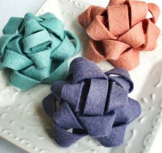 Felt bows - I suppose they could be made using the technique I've seen for gift wrapping/ribbon | http://doityourselfgiftideas.micro-cash.org