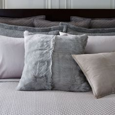 This Ralph Lauren Home elegant decorative throw pillow is crafted from luxurious long-haired goat shearling