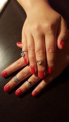 Red nails, heart and crown rings
