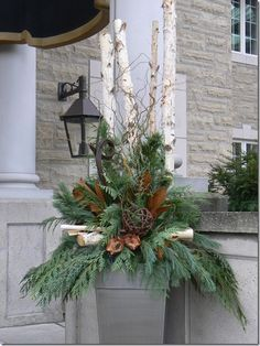Wonderful winter and evergreen container! Love all the different yet simple accents. Winter container garden