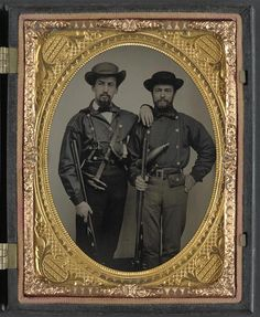 """Two unidentified soldiers in Mississippi battle shirts with double barrel shotguns, knives, and powder horns,"""" hand-colored ambrotype (Library of Congress)."""