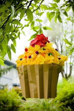 a cupcake-shaped pinata filled with cupcakes? I can't begin to wrap my head around the logistics, but I want it. I want it bad.