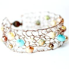 I discovered this Metallic Copper Cuff Bracelet / Ivory Turquoise Peach Sepia Southwestern / Wire Jewelry Semiprecious Stone & Pearl on Keep. View it now.
