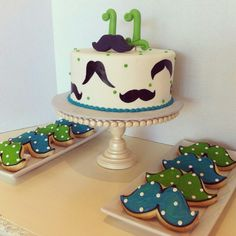 A moustache themed party! So fun and trendy, with a fancy moustache cake and matching sugar cookie favors. Yum.