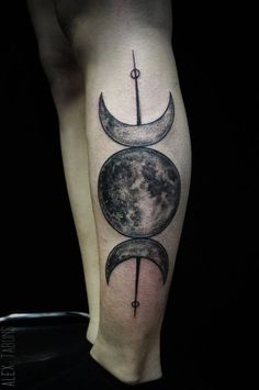 Blackwork/illustrative moon phases on the left leg.