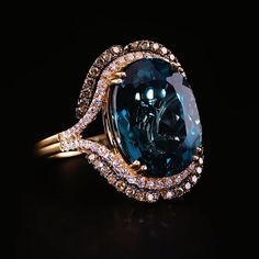 Le Vian Deep Sea Blue Topaz™ Ring in Strawberry Gold® with Vanilla Diamonds® and Chocolate Diamonds®.