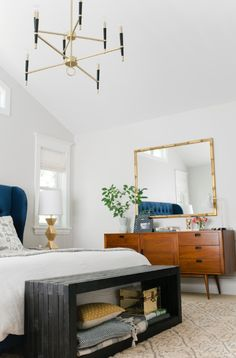 The bedroom via Emily Henderson. I am in love with this mid century dresser and bamboo mirror combination. Walls are Crushed Ice by Sherwin ...