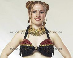 American Tribal Style® (ATS®) belly dance black cotton bra. The top halves of the bra cups are covered with silk brocade recycled sari remnants. Black fringe hangs across the mid-cup with brassy goldtone metal buttons. Fits up to C cup when worn alone, up to D cup when used over a choli. There may be slight variations in the sari colors/pattern from the pic. Ties behind neck and back.