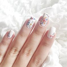 Random floral clusters for this Friday morning! I used @colourgossipnails's Saved for my white base, and a whole bunch of acrylic paint. ✌️mattified using @opi_products matte top coat! comment if you'd like to see a video for this! Thank you for reading! ❤️