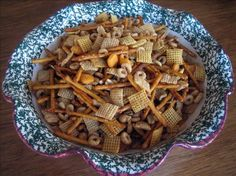 Amy's Texas Trash 1 box Wheat Chex 1 box Rice Chex 1 box Cheerios 1 bag pretzel sticks 2 cans of planters mixed nuts with sea salt 1 1/2 cup bacon grease, melted 1Tbl butter flavoring 1/4 cup Worcestershire 2 1/2Tbs Cholula 6 Tbs Roasted garlic, I use a lot... 1 1/2 Tbs seasoned salt DIRECTIONS Combine cereals, pretzels and nuts in a very large oven-proof bowl or pan. Mix butter, bacon grease and seasonings together. Pour liquid over cereal mixture and stir. Bake 1 hour at 250° , stirring oc...