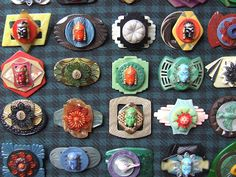A Piece of Cloth Studio - brooches made from old belt buckles and buttons. Gorgeous.