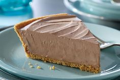 Sweet chocolate, cream cheese and whipped topping form the filling for this dessert that is frozen in a graham cracker pie crust.