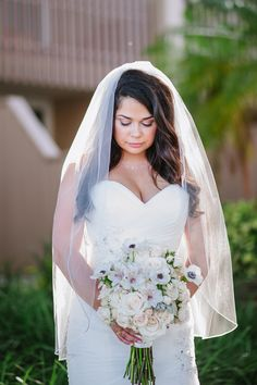bride in a Sophia Tolli gown and stunning white bouquet by Nery's Flowers / photo by soulechostudios.com