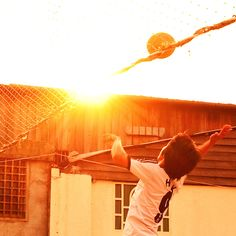 For the love of light. Afternoon game in Timor Leste village. Photographed by Scott Woodward.