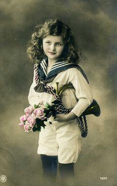 Little girl in sailor suit (vintage postcard)