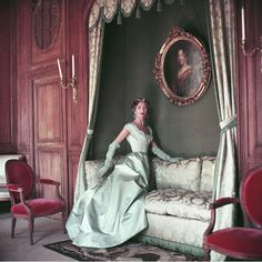 Photographed by Mark Shaw in 1953 at the French country estate, Corbeville, Jane Sprague models a ball gown by Jacques Fath.