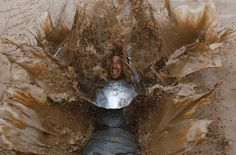 BEST PICTURES OF 2014   © Darren Staples/Reuters  Perton, UK, A competitor falls into muddy water during the Tough Guy event on January 26. The annual event to raise cash for charity challenges thousands of international competitors in a cross country run followed by an assault course consisting of obstacles including water, fire and tunnels.