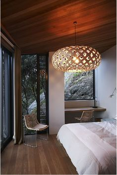 A beautiful home in NZ by Architect Stevens Lawson houses several David Trubridge lights! #design #decor #home