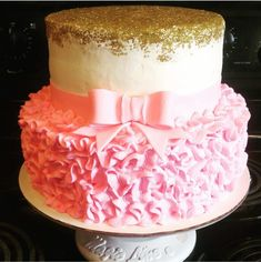 Baby shower, girls birthday cake. Gold and pink. Gold sprinkles, pink ruffles and bow. Messi Jessi's Custom Cakes