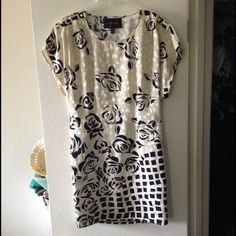 Printed Shift Dress Fasteners on either side to cinch waist. Can be worn with or without them as show above. Classic and statement piece for your closet! Dresses