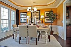 Ashley V - Creekstone by Pulte Homes Dining room with yellow/gold wall paint.  Great ceiling molding with additional strip of the yellow paint again.  I really like this paint color.