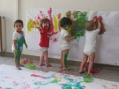 Toddlers exploring all movements of body with paint, looks like so much fun!