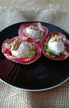 Palline di ricotta con basilico e noci su letto di insalatina e bresaola