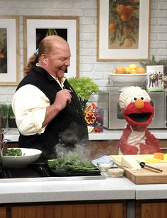Mario Batali cooking with Elmo on The Chew